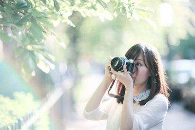 A landscape architect taking a photograph