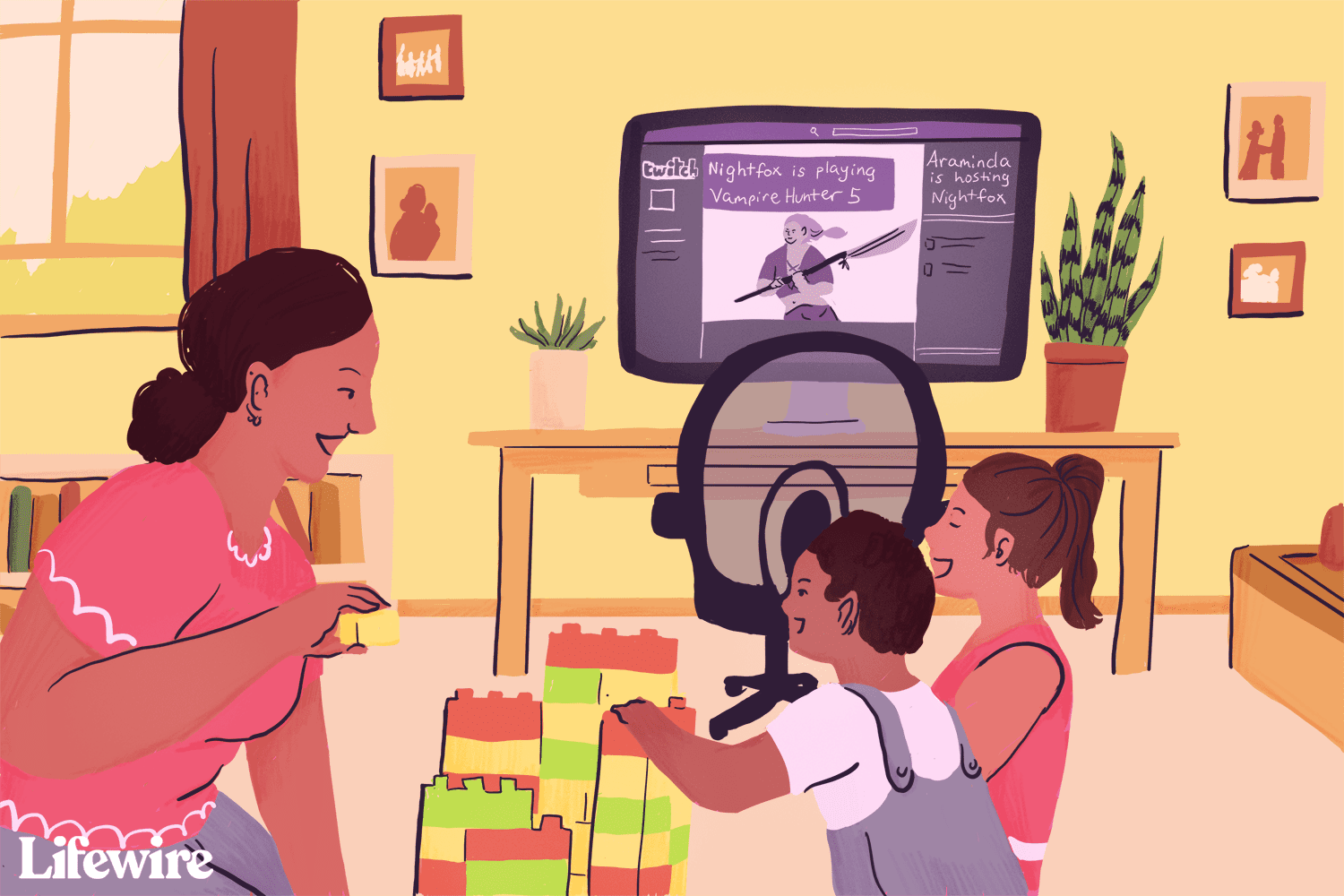 A woman playing with her children in front of a computer showing a Twitch stream