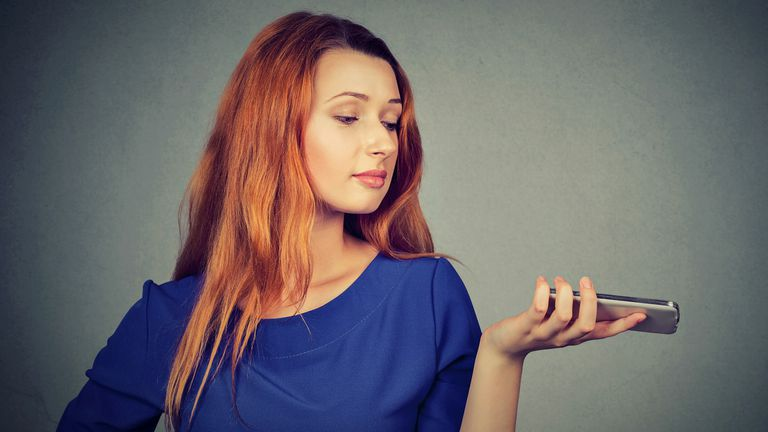 Woman looking frustrated at her smart phone