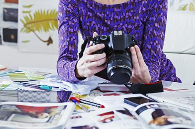 An amature photographer with a camera
