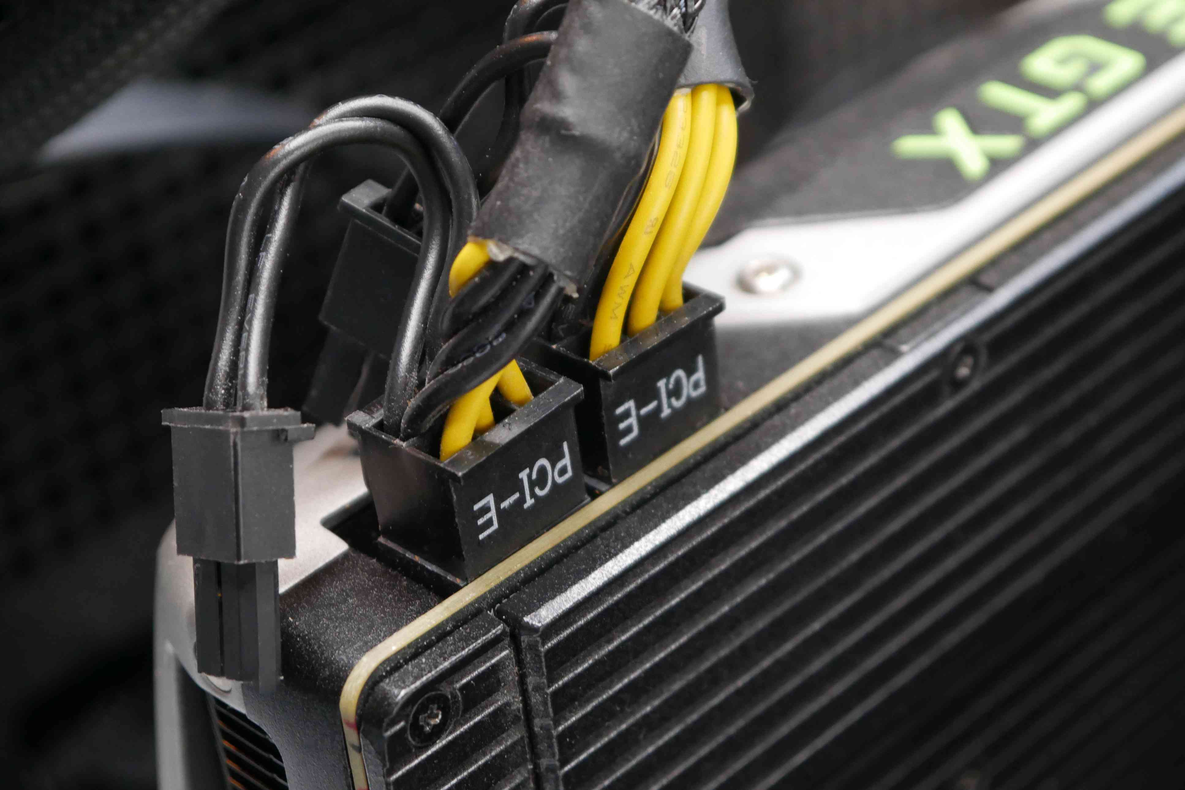 A photo of PCIe power connectors plugged in to a graphics card