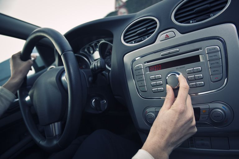 A driver tunes in an HD radio station.