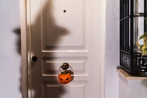 Shadow of a girl dressed in halloween costume Trick-Or-Treating