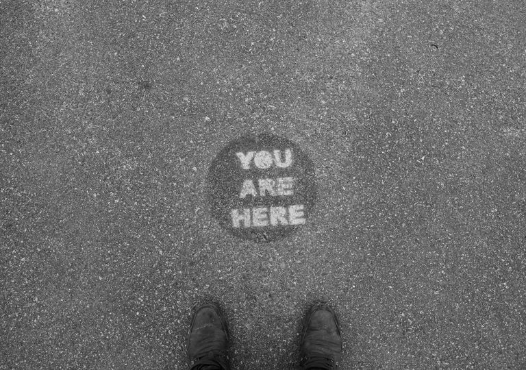 You Are Here Marker on asphalt