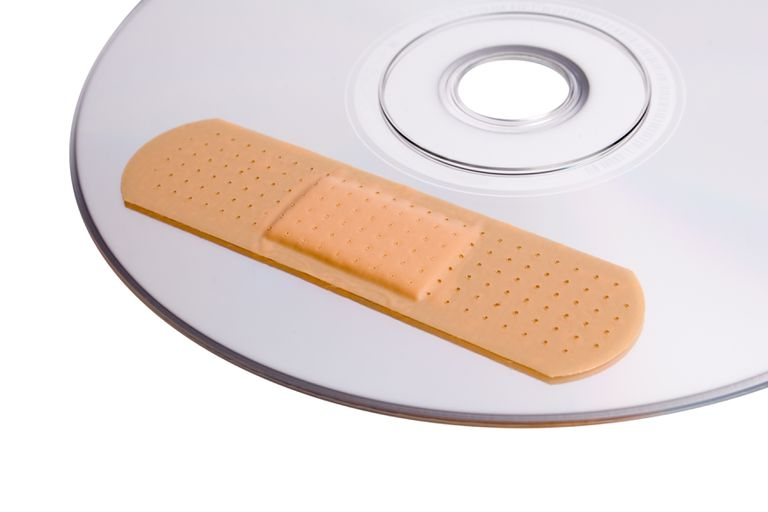 CD with bandaid, indicating that it's been scratched due to unsafe cleaning