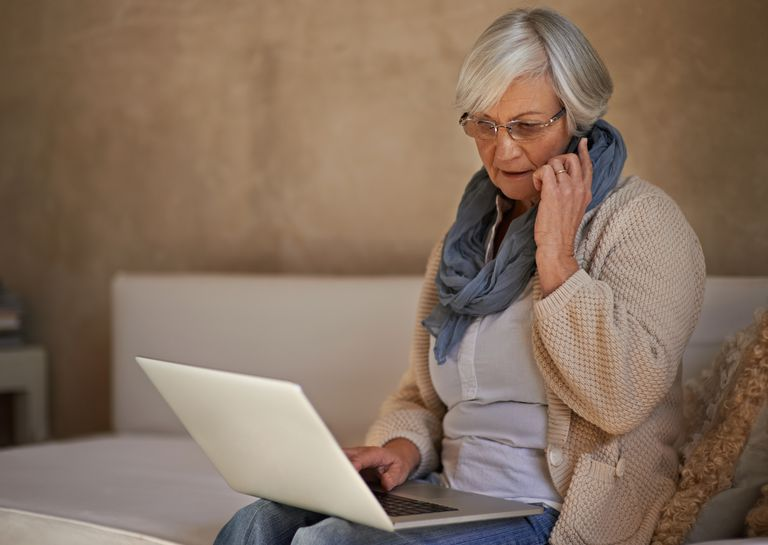 Woman on mobile phone and laptop