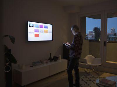 man controlling Apple TV with iPad