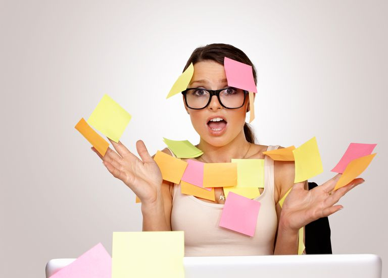 Stressed businesswoman with sticky notes stuck to her body