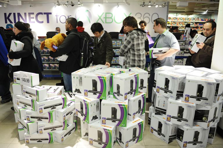 Xbox Live in boxes at store; guys on line waiting to pay