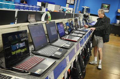 A consumer shops for a laptop computer