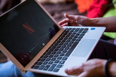 Woman watching Netflix on laptop.
