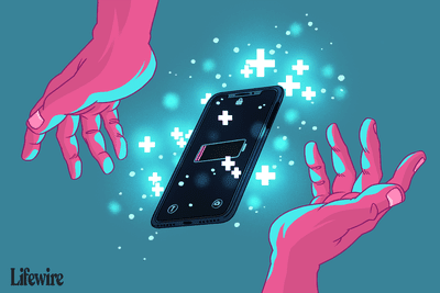 Two hands reaching towards a smartphone with low battery surrounded by plus symbols