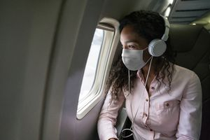 Woman listening to music on a flight