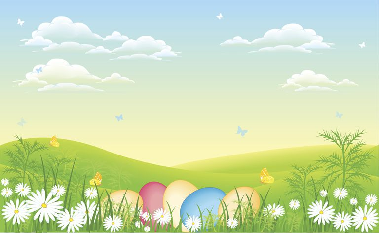 Pastel Easter eggs and daisies in an open sunny field