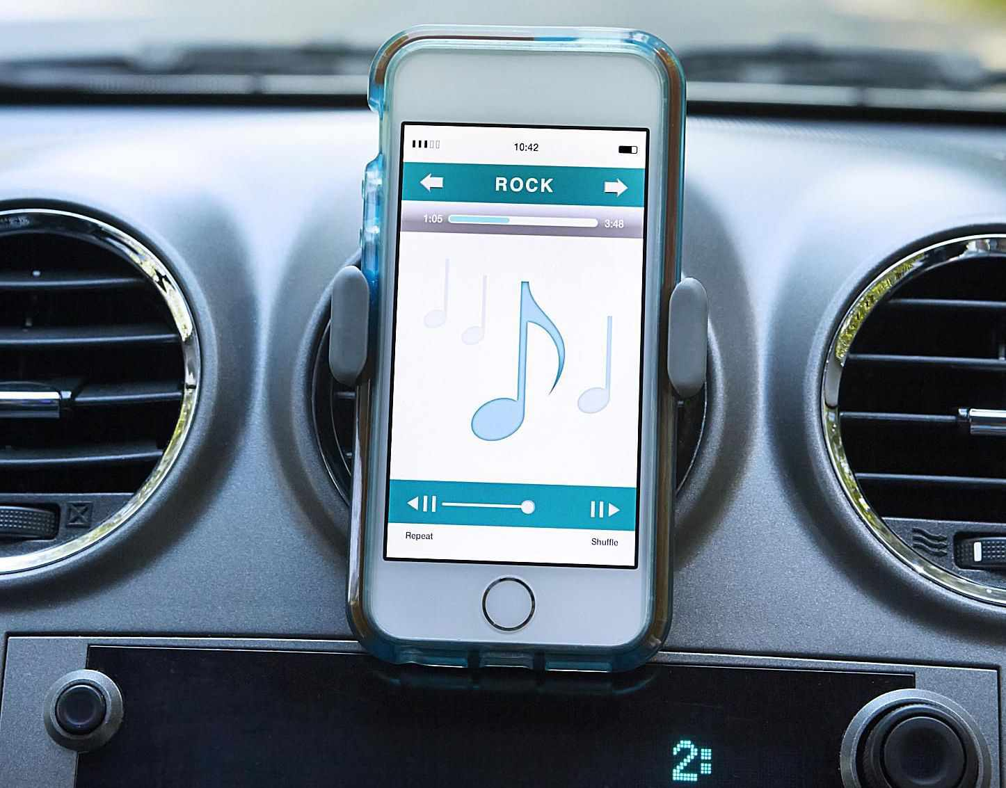 iPhone playing rock music through a Bluetooth connection in car