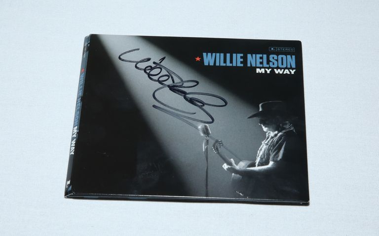 A signed Willy Nelson LP, example of collectible auctioned off