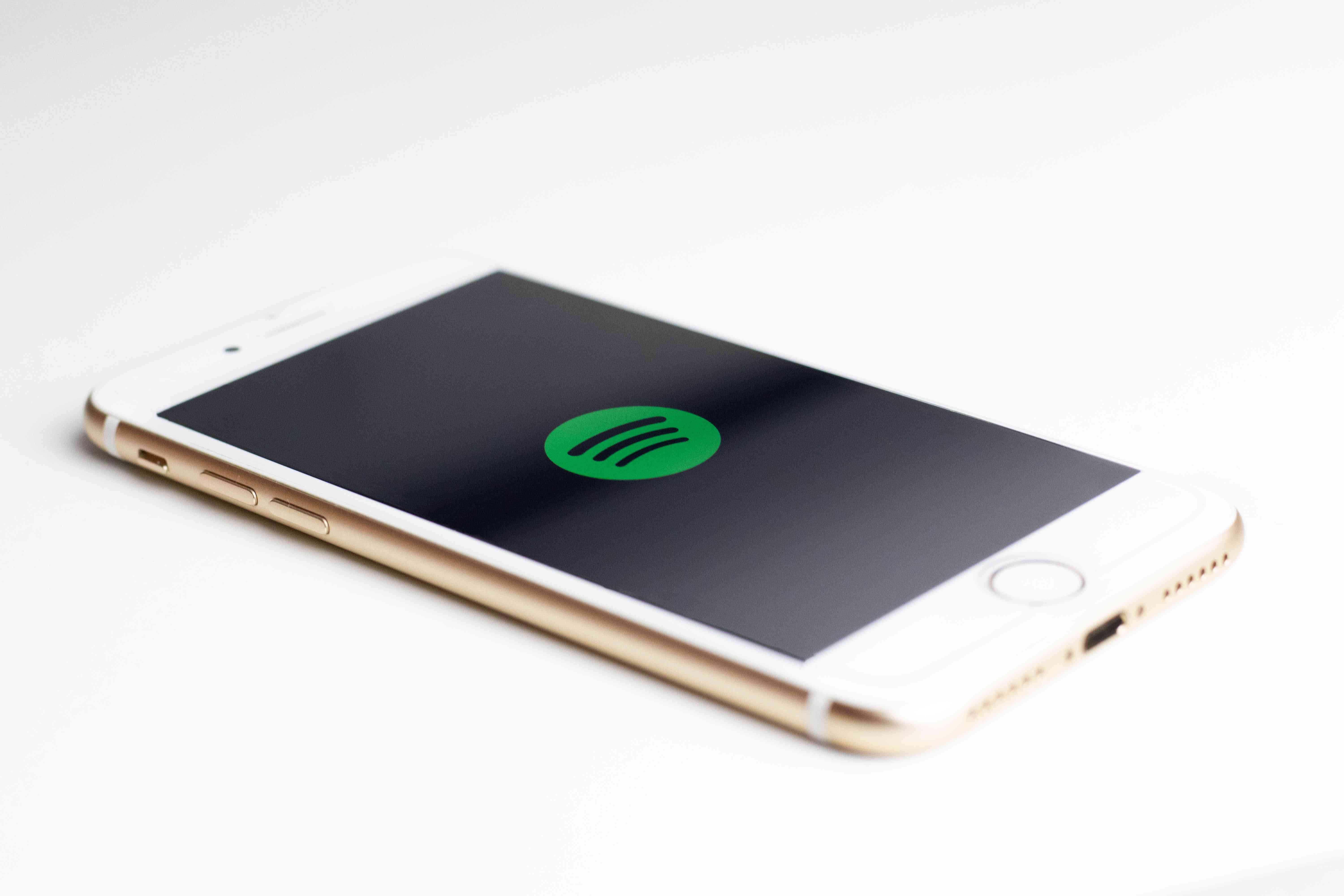 The Spotify logo displayed on an iPhone.