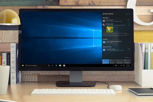 Windows 10 operating system on a desktop computer monitor on a desk with keyboard and mouse