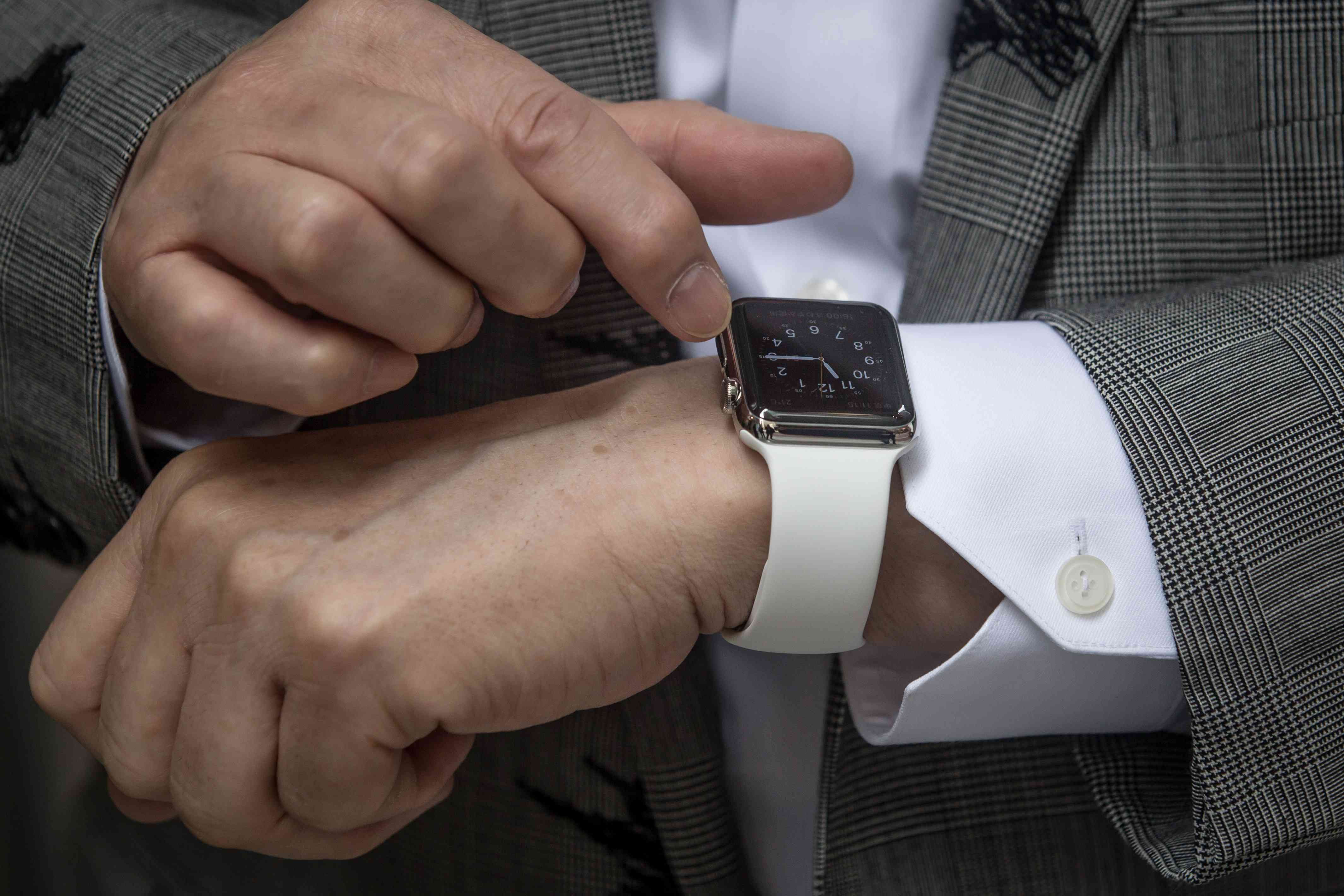Apple Watch on a man's wrist about to be powered down