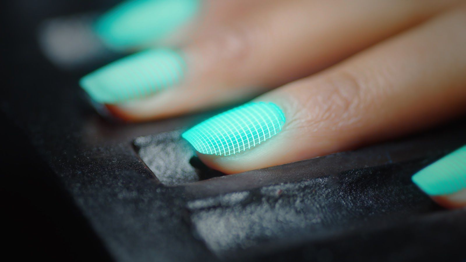 Interior close up shot of a person's hand inside Nimble AI nail machine