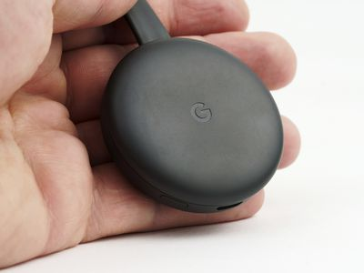 Chromecast held in a person's hand