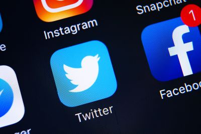A smartphone screen showing the Twitter app icon.