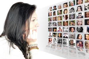 Portrait photographer examining a photo album