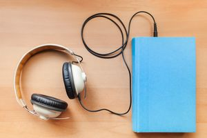 headphones plugged into a book