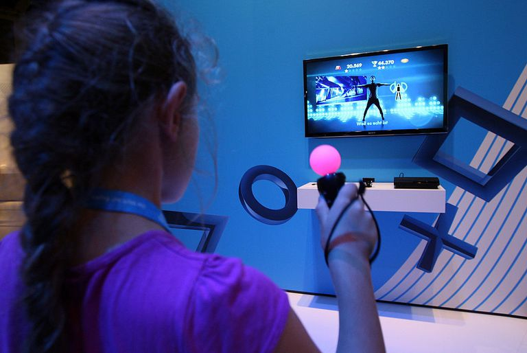 Young girl playing Playstation Move