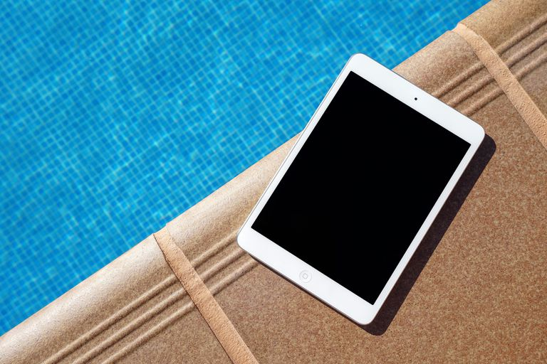 iPad next to a swimming pool