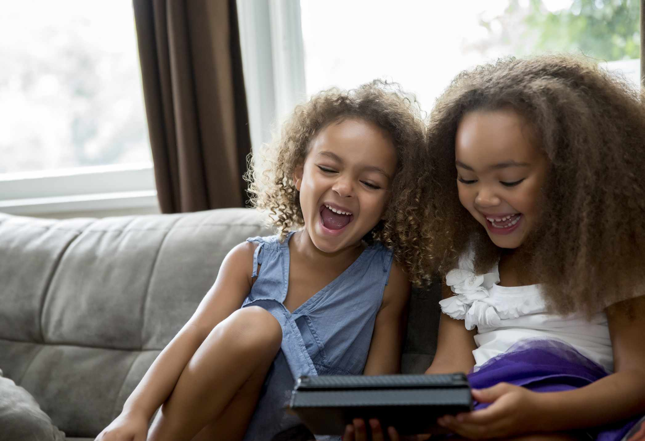Children streaming entertainment on a tablet computer.