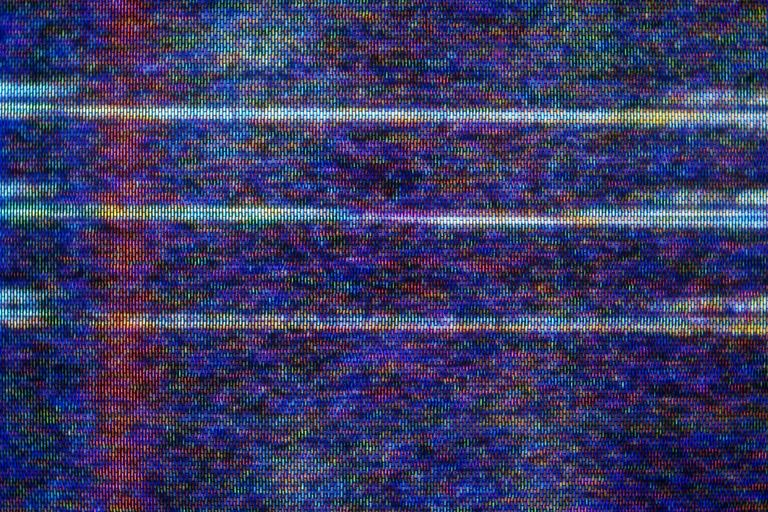 Close-up photo of static on a TV or monitor screen
