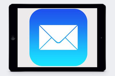 The iOS Mail logo on an iPad