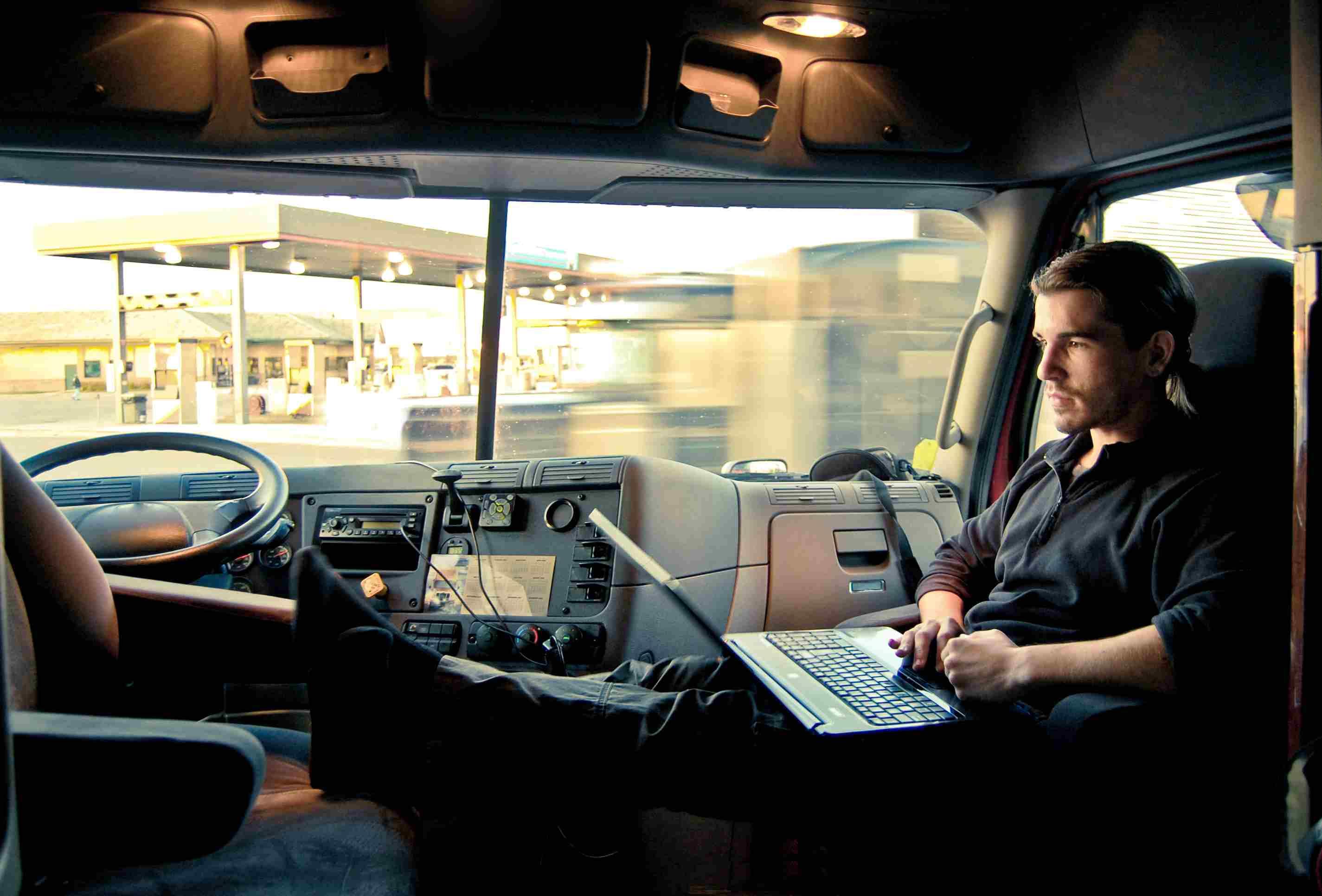 Truck driver enjoying Wi-Fi at truck stop