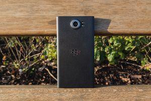 BlackBerry phone posed on fence