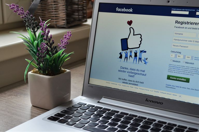 An image of the Facebook login page on a laptop.