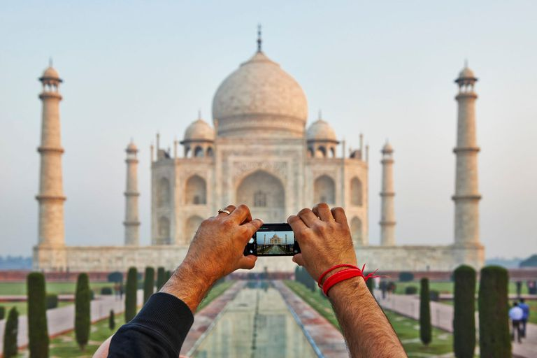 taking a cell phone video of the Taj Mahal