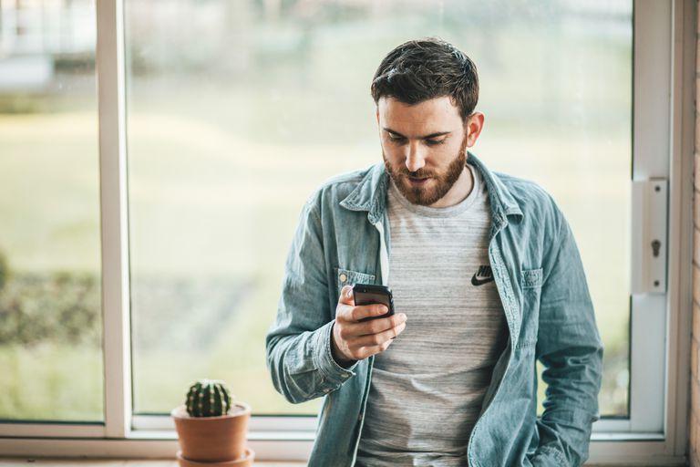 young man looking at his phone