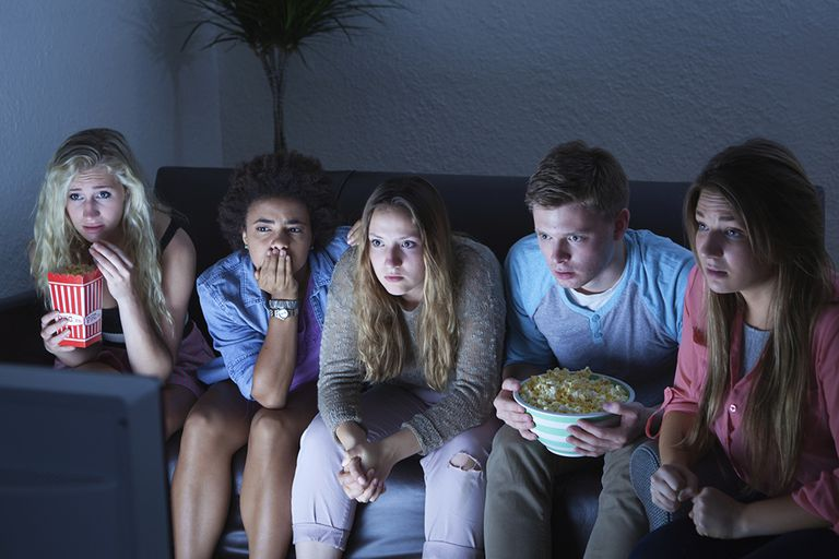Group of teens watching television