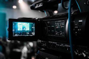 Movie camera filming a scene