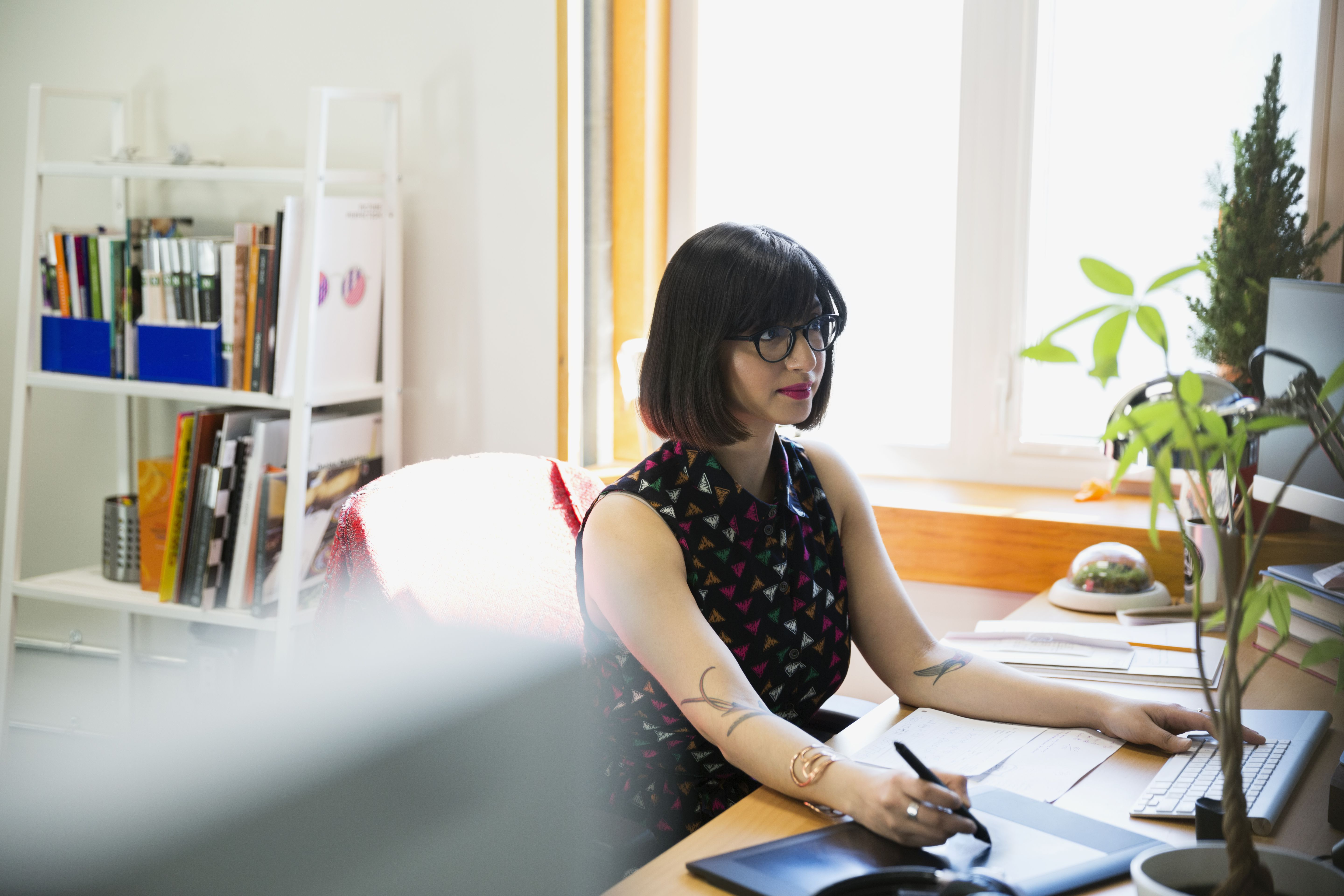 Graphic designer working with drawing tablet in office