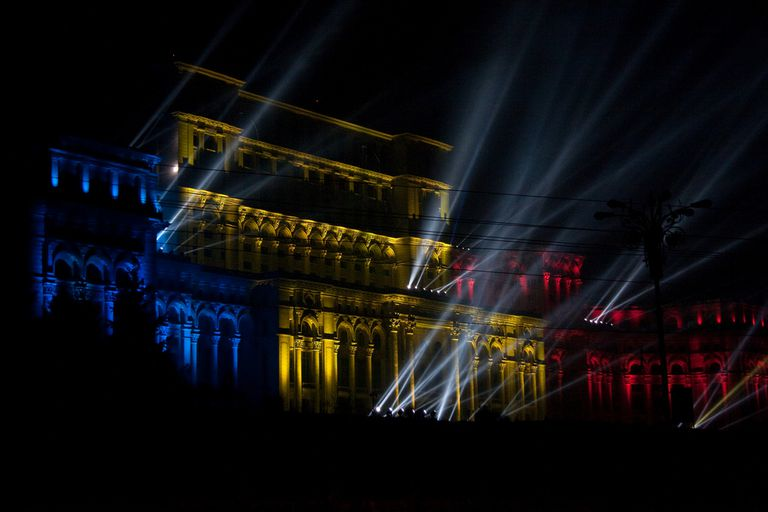 Romanian Parliament lit up like the flag