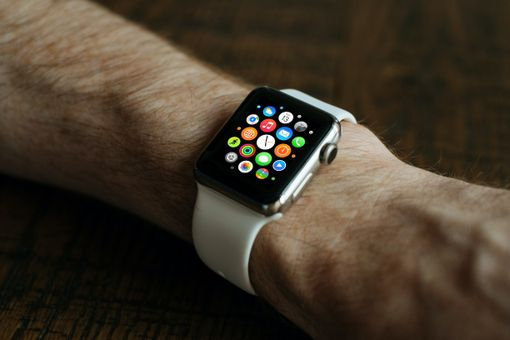 Someone wearing an Apple Watch with the apps displayed on the screen.
