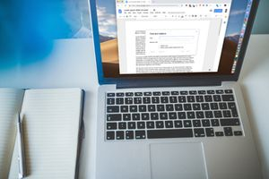 Mac laptop with Google Docs Find and Replace on the screen