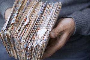 Man holding letters in envelopes