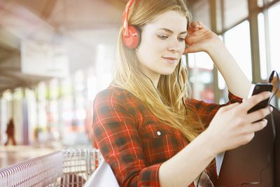 Woman listening to music on Amazon music service