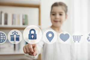 A child touching a virtual lock icon.