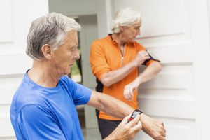 older couple checking their fitness trackers