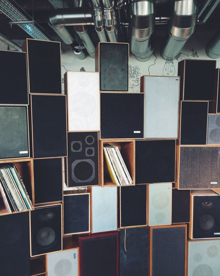 Stacks of different speakers in a room