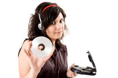 Person listening to music on a CD